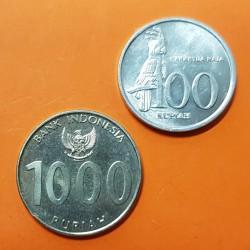 2 monedas x INDONESIA 100 RUPIAS 1999 LORO KM.61 ALUMINIO + 1000 RUPIAS 2010 EDIFICIO KM.70 NICKEL SC-
